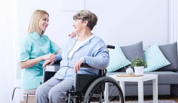 how to transfer a paralyzed patient from wheelchair to bed